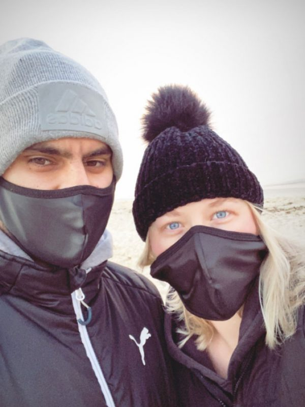 couple wearing face masks outdoors