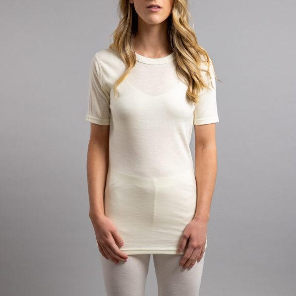Front view of a female wearing white Merino Skins – Unisex Short Sleeve Crew Neck