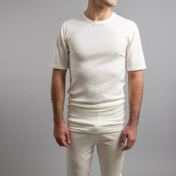 Front view of a male wearing white Merino Skins – Unisex Short Sleeve Crew Neck