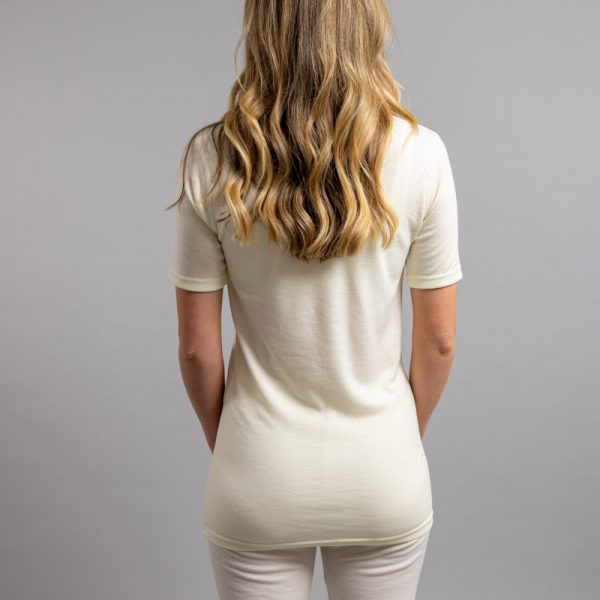 Rearview of a female wearing white Merino Skins – Unisex Short Sleeve Crew Neck
