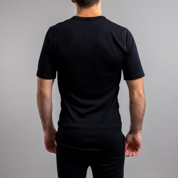 Rearview of a male wearing black Merino Skins – Unisex Short Sleeve Crew Neck