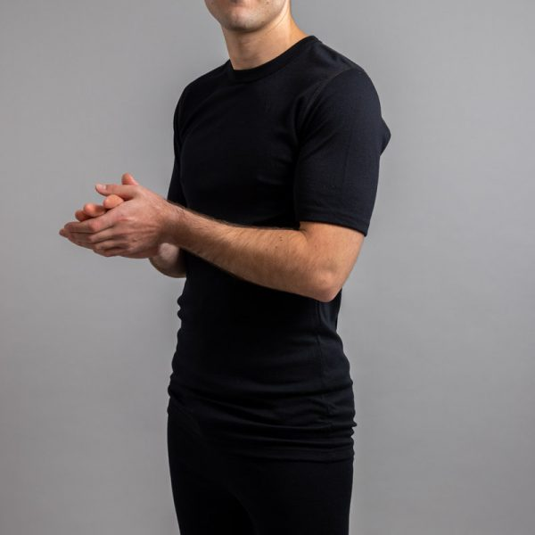 Front side view of a male wearing black Merino Skins – Unisex Short Sleeve Crew Neck
