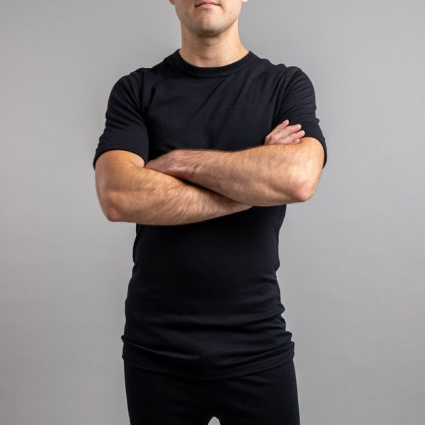Front view of a male wearing black Merino Skins – Unisex Short Sleeve Crew Neck