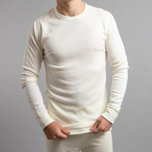 Front view of a male wearing white Merino Skins – Unisex Long Sleeve Crew Neck