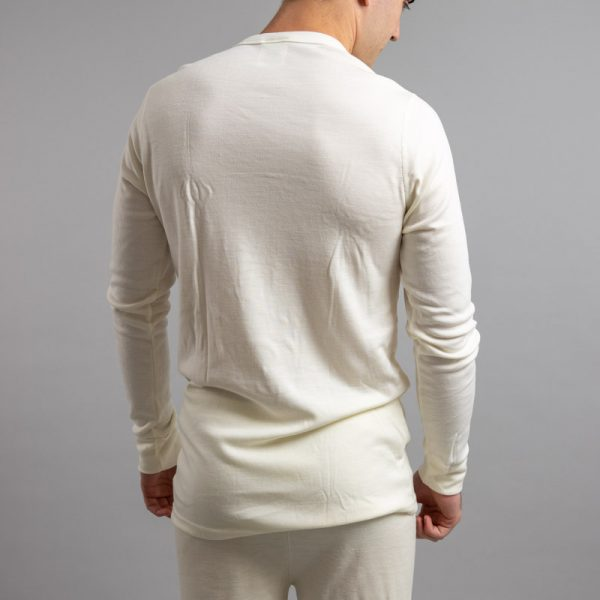 Rearview of a male wearing white Merino Skins – Unisex Long Sleeve Crew Neck