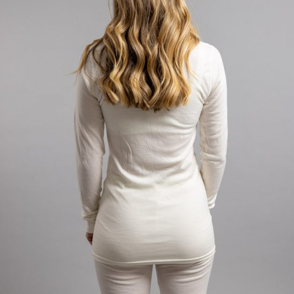 Rearview of a female wearing white Merino Skins – Unisex Long Sleeve Crew Neck