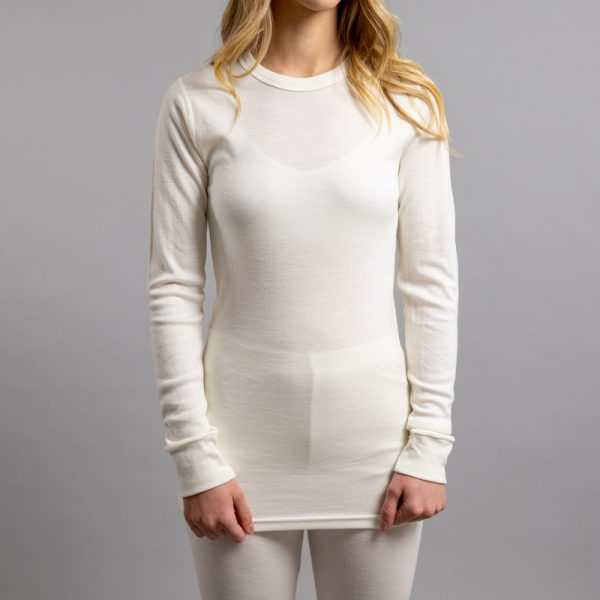 Front view of a female wearing white Merino Skins – Unisex Long Sleeve Crew Neck