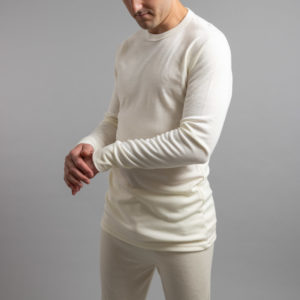 Front side view of a male wearing white Merino Skins – Unisex Long Sleeve Crew Neck