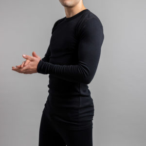 Front side view of a male wearing black Merino Skins – Unisex Long Sleeve Crew Neck