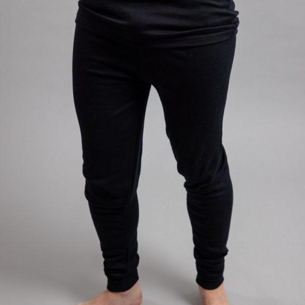 Front view of a male wearing black Merino Skins - Unisex Long John / Pant
