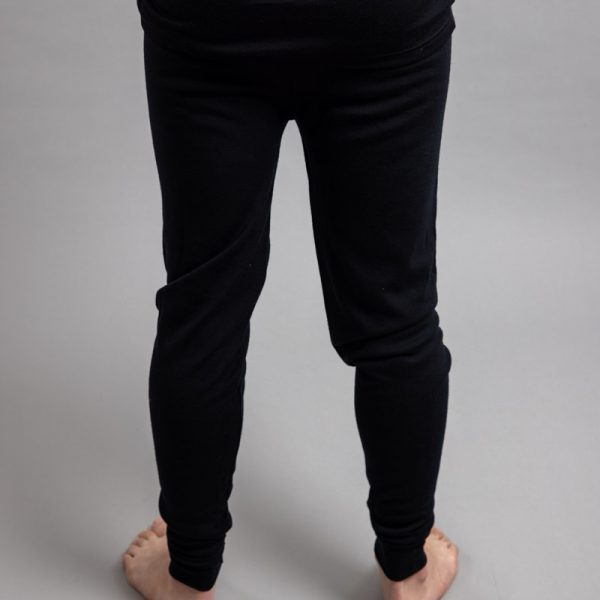 Rearview of a male wearing black Merino Skins - Unisex Long John / Pant