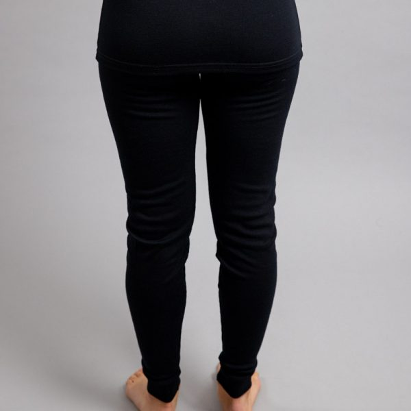 Rearview of a female wearing black Merino Skins - Unisex Long John / Pant