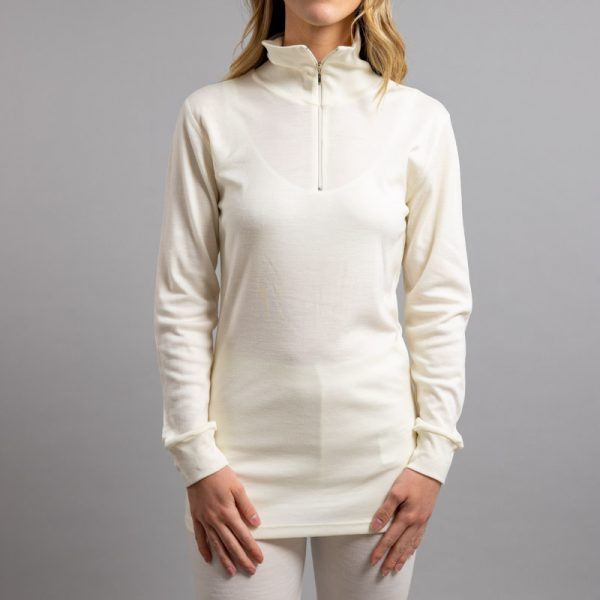 Front view of a female wearing white Merino Skins – Unisex Long Sleeve Half Zip Front