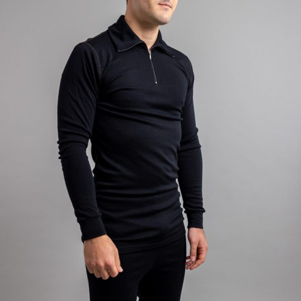 Front side view of a male wearing black Merino Skins – Unisex Long Sleeve Half Zip Front