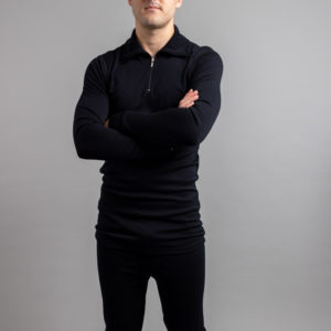 Front view of a male wearing black Merino Skins – Unisex Long Sleeve Half Zip Front