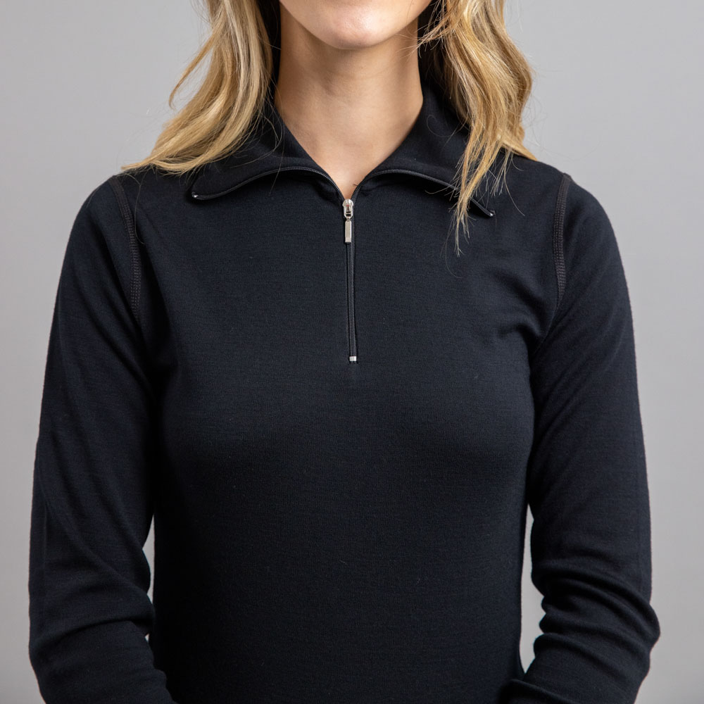 Front view of a lady wearing black Merino Skins – Unisex Long Sleeve Half Zip Front